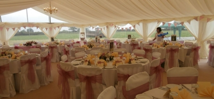 Beautiful drapes and lighting to complete the look of your perfect wedding venue.